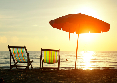 The Retirement of the Monthly Mash | Beach Chairs on Sand at Sunset